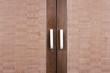 brown wood closet doors with handles