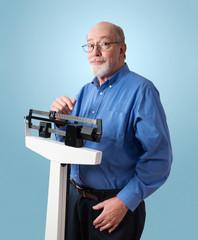 Happy Senior Man on Weight Scale
