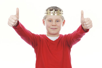 Young boy with crown giving you thumbs up