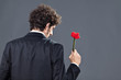 Man giving fabric rose