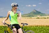 biker with bottle of water, Hazmburk, Ceske stredohori, Czech Re