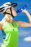 portrait of biker with bottle of water
