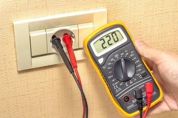 metering socket voltage with digital multimeter