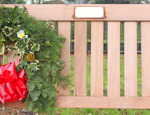 Memorial bench with wreath and name plaque