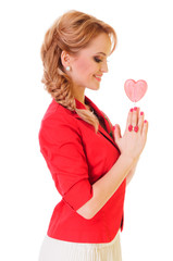 woman holding heart-shaped candy