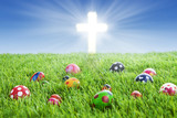 Easter eggs and Cross on grass