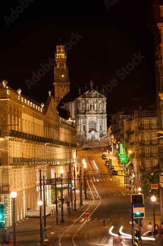 Porto street at night. Clérigos tower and church, Portugal