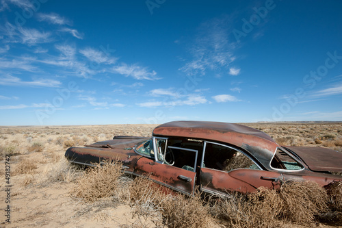 canvas print picture Old rusted car in the middle of New Mexico desert