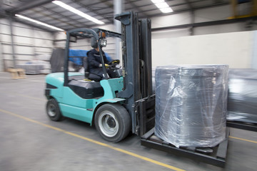 Forklift carrying cargo in factory