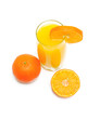 orange juice in a glass and oranges - top view