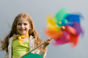 Summer joy - girl with colored pinwheel
