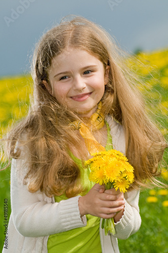 Allergy season, pollen - lovely girl with dandelion flowers