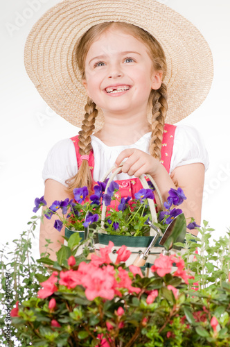 Gardening - lovely gardener with flowers seedlings