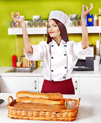 Female chef holding  food.