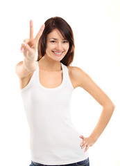 Portrait of a pretty young woman showing the peace sign