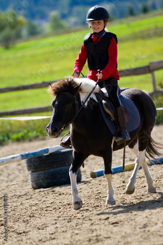 Horse riding -  lovely equestrian on a pony