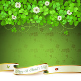 Saint Patrick's Day greeting card with clover and ribbon