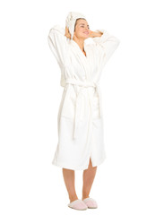 Full length portrait of woman in bathrobe enjoying freshness
