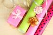 Rolls of Christmas wrapping paper with ribbons, bows