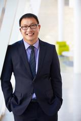 Portrait Of Businessman Standing Modern Office Reception