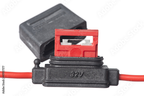 Isolated shot of fuse holder with fuse and cover