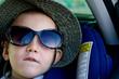 Little boy wearing Mums sunglasses