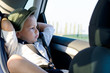 Leinwanddruck Bild - Little boy in a child safety seat