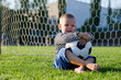 Laughing little boy with his soccer ball