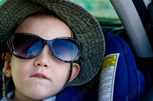 Little boy wearing Mums sunglasses