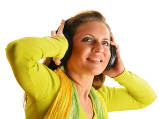 Happy young woman listening to the music in headphones isolated
