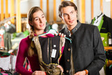 Young couple is buying Tracht or dirndl in a shop