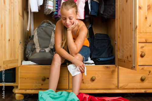 Family - child in front of her closet or wardrobe