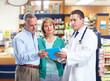 Pharmacist with a senior couple.