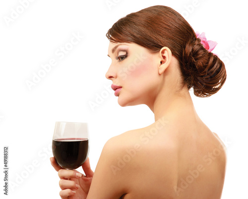 Beautiful brunet girl drinking red wine