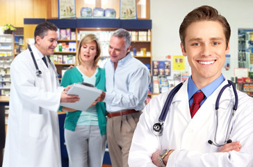 Pharmacist with a senior couple.