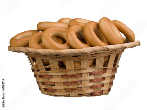 Tasty bagels in the basket isolated on white