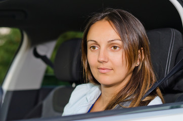 Attractive woman sitting in a car