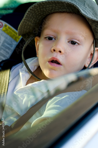Adorable little boy in a car