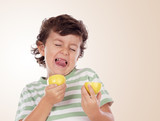 Cute child eating a lemon