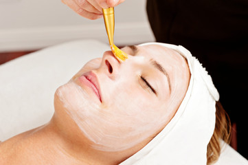woman relaxing during a facial treatment