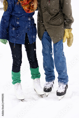 Couple wearing ice skates