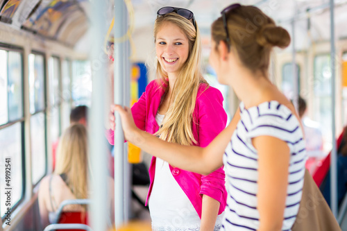 Pretty, young woman on a streetcar/tramway