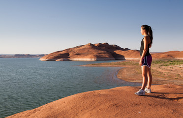 Young woman working out atLake Powell