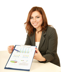 A businesswoman showing statistics results in a folder