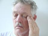 senior rubs the corner of his eye