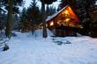 Leinwanddruck Bild - Cabin In Woods At Dusk