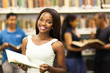 beautiful african american college girl in library