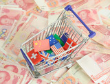 shopping cart with national flag on a lot of Renminbi poster