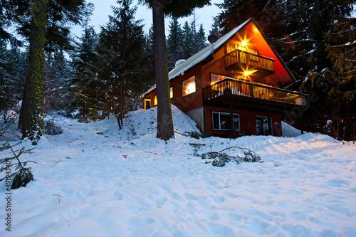 Leinwanddruck Bild Cabin In Woods At Dusk