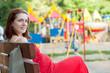 pregnancy woman against  playground